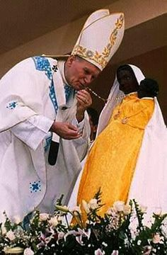 black madonna pope john paul kissing
