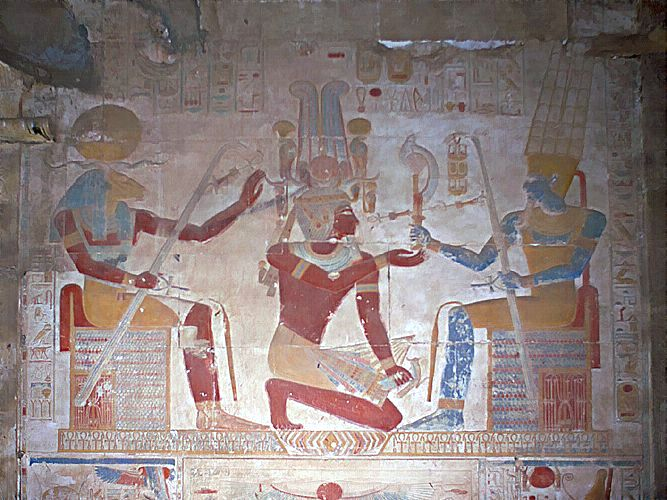 ph. Seti I receives royal regalia from the Ram headed Khnum and Amon